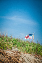American flag on a flag pole on a hill