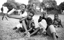 Boys playing in grass field
