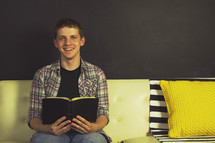 teen boy reading a Bible