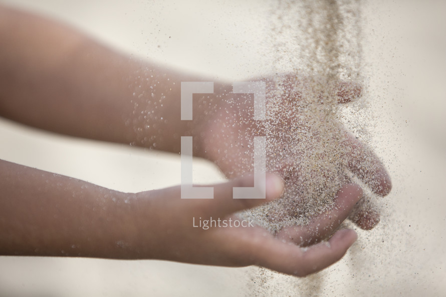 sand through the hands of a child