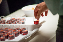 communion wine in cups on a tray