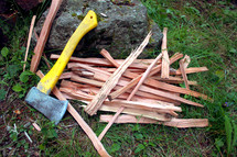Hatchet with chopped wood.