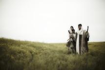 Mary and Joseph traveling to Bethlehem.