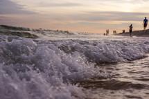 closeup of the tide washing onto a beach