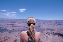a woman looking out at a canyon view