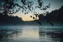 mist over a lake at sunrise