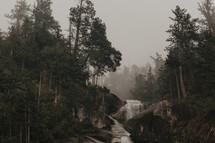 moody mountaintop waterfall