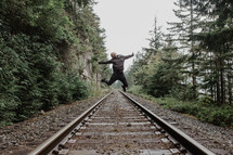 jumping high above train tracks