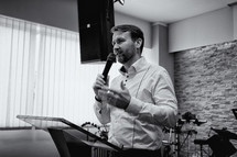 worship leader holding a microphone