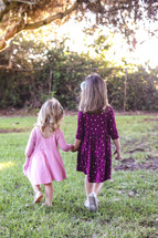sisters walking holding hands