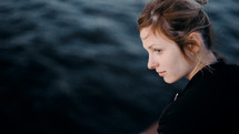 side profile of a young woman on a ferry