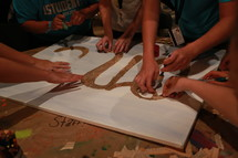 Teens making a poster.