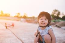 a girl in a bike helmet