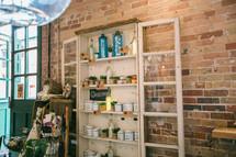 jars and trinkets on a wooden bookshelf