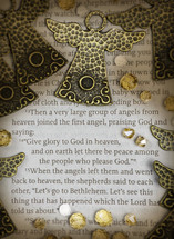 Close-up scripture with angels and jewels. Luke 2:13-15
