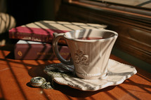 tea cup and saucer with a locket