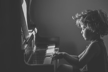 child playing a piano