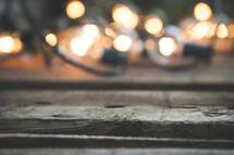 string of lights on wood