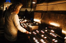 lighting prayer candles