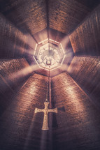 rays of sunlight from skylights in the ceiling of a church
