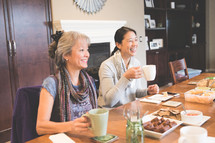 women's group with tea and appetizers