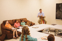 A man teaching Bible lessons to children at church.