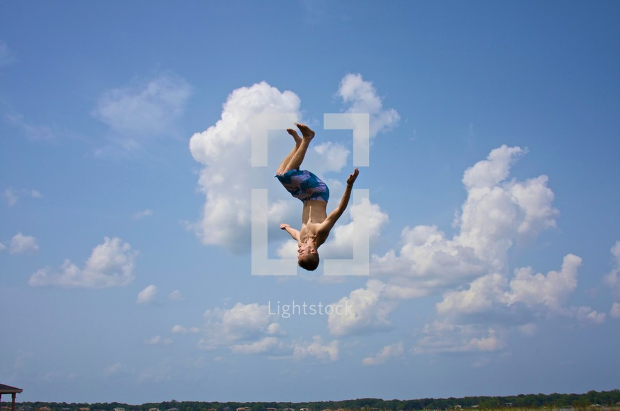 boy doing flip - sky background