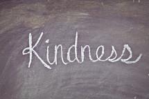 Kindness written on a chalkboard