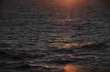 sunlight shining on the ocean surface