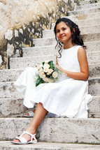 girl in a white dress for her first communion