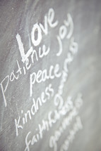 The Fruit of the Spirit - love, patience, kindness, faithfulness, peace, joy, and gentleness written on a chalkboard