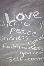 The Fruit of the Spirit - Love, Peace, Kindness, Faithfulness, goodness, Patience, self-control written on a chalkboard