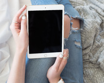 a woman holding an iPad