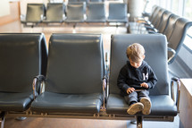 a boy child sitting in a waiting area