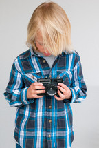 a boy child holding a camera