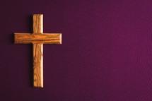 olive wood cross on purple
