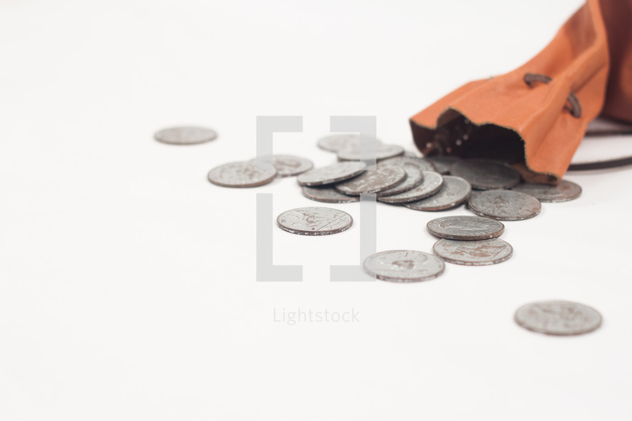 spilled coins and leather bag