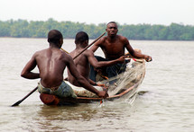 three men fishing on the Calabar River