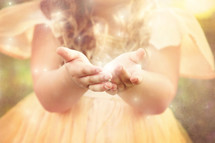 a girl holding twinkling light