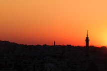 Silhouette of a mosque and city