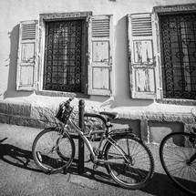 bikes parked along a sidewalk