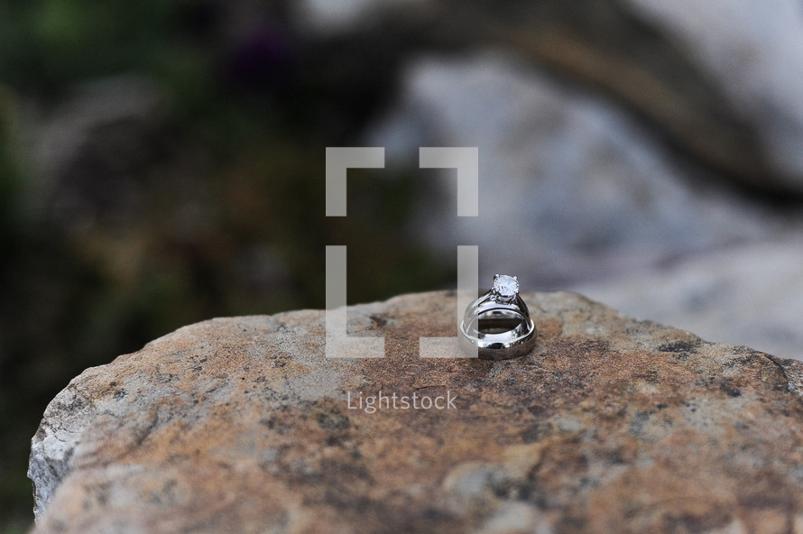 wedding bands on rocks