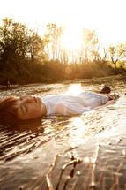 boy lying in water