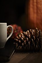 pine cone and coffee mug