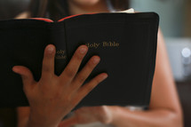 Girl reading Bible