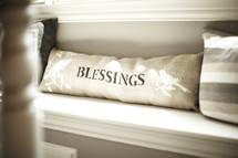 A pillow with the word blessings on it