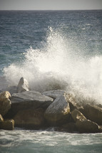 ocean crashing into rocks