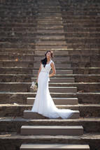 bride on outdoor amphitheater stairs