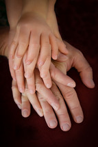 Closeup of families hands