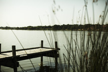 A wooden dock out in the lake